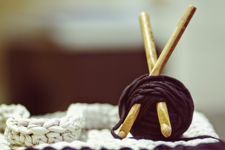Ball of yarn with crochet hooks