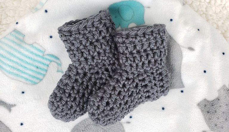 Simple Crochet Baby Booties on a baby blanket | Marching North