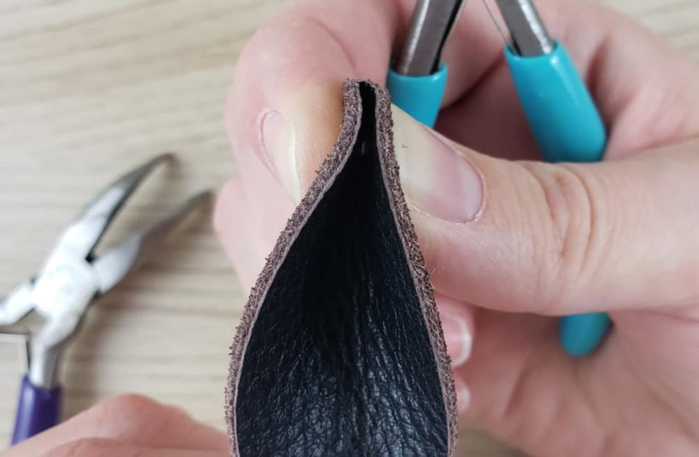 Pinch leather earring together and line up the holes