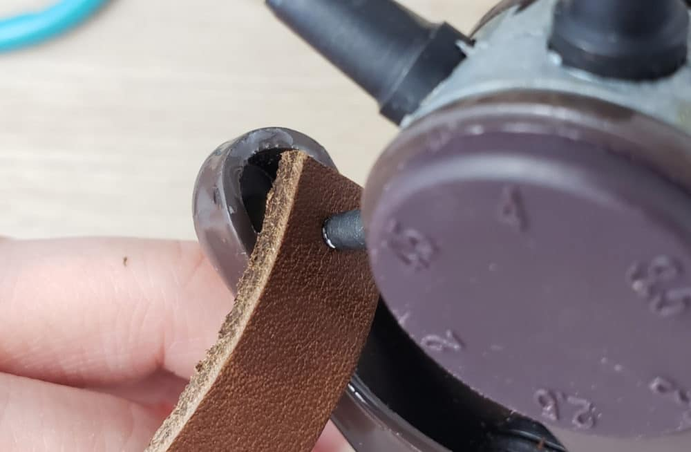punching hole in leather earring