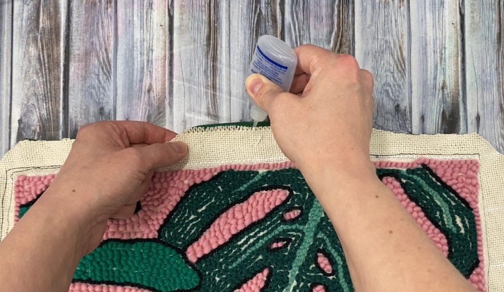add fray check to the raw edges of punch needle pillow