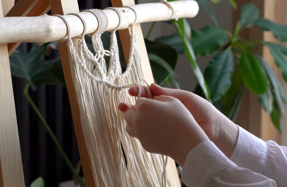 person doing macrame