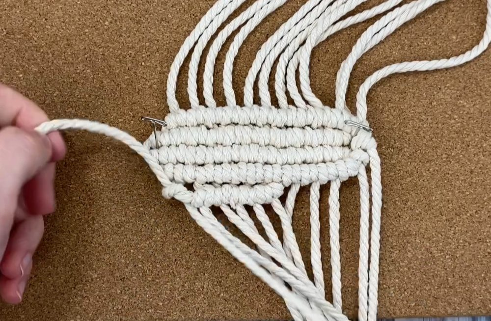 Tie a row of double half hitch knots in the other direction