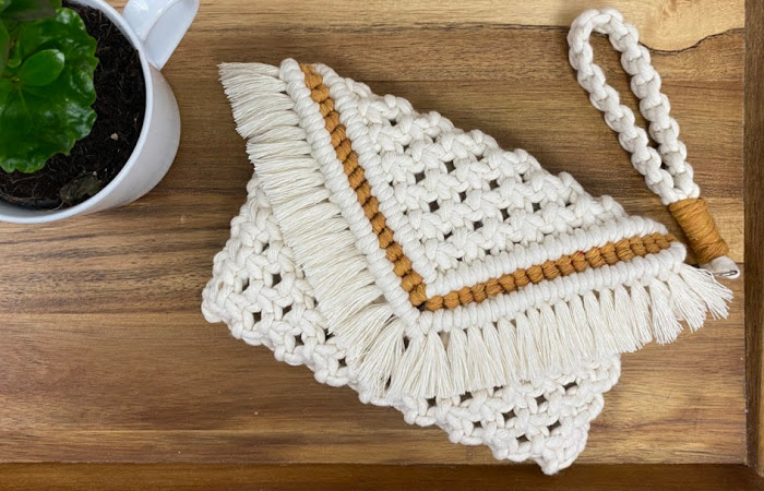 DIY macrame purse on wooden tray with plant